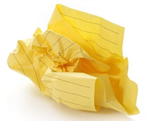 Crumpled ball of yellow legal paper