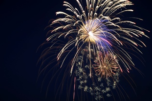 Fireworks light the night sky during the Independence Day Celebration at Whiteman Air Force Base, Mo., June 30, 2016. This was the first year the show used 8-inch shells, versus the usual 6-inch shells, for a bigger display for Whiteman personnel and their families. (U.S. Air Force photo by Senior Airman Danielle Quilla)